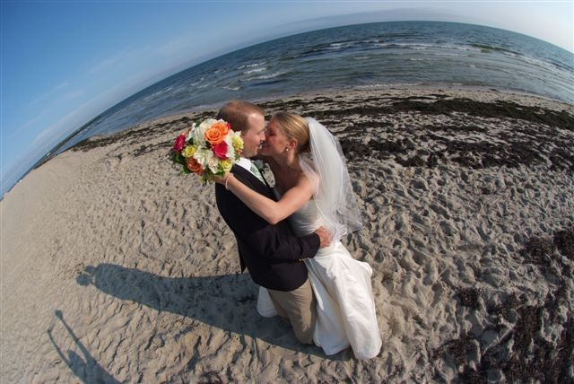 Cape Cod Wedding Couple embrace on beach